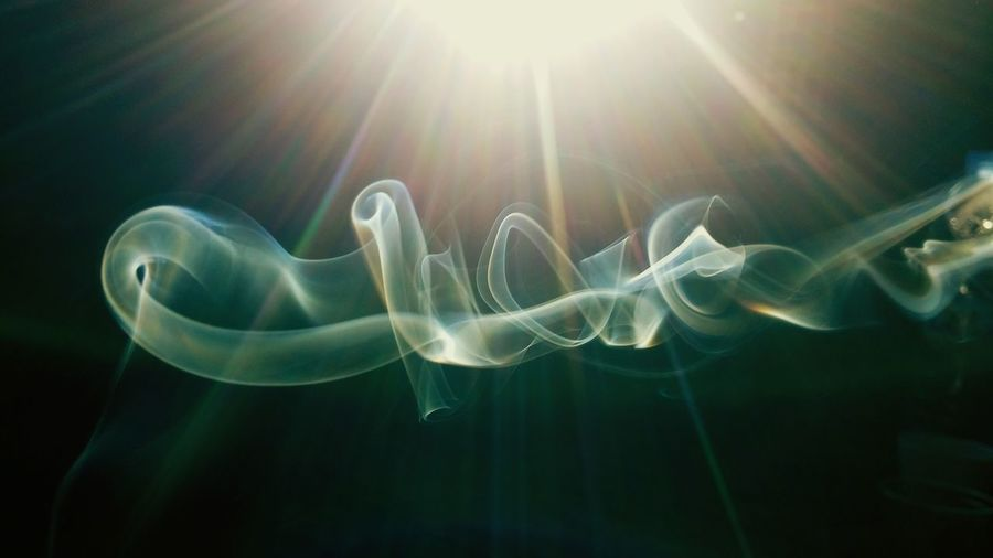 Close-up of smoke during sunny day