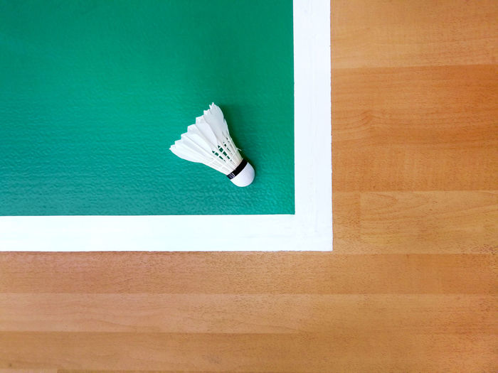 High angle view of white umbrella on wooden table