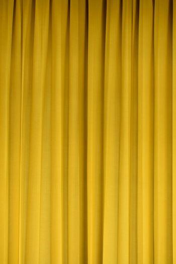 Full frame shot of yellow curtain
