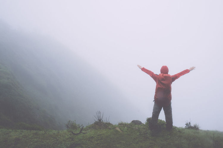 Free Freedom Hiking Arms Outstretched Day Fog Foggy Landscape Mist Nature One Person Outdoors People Real People Rear View