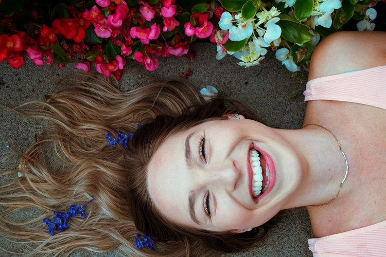 Portrait of smiling young woman lying down