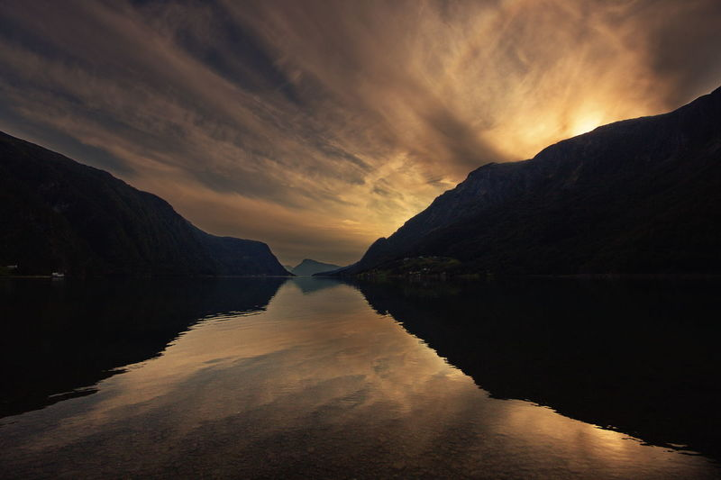 Mountain, fjord and clouds Water Sky Tranquil Scene Scenics - Nature Tranquility Beauty In Nature Sunset Cloud - Sky Mountain Reflection Idyllic Nature No People Non-urban Scene Environment Waterfront Silhouette Fjord Norway Scandinavia Travel Adventure Activity Hiking