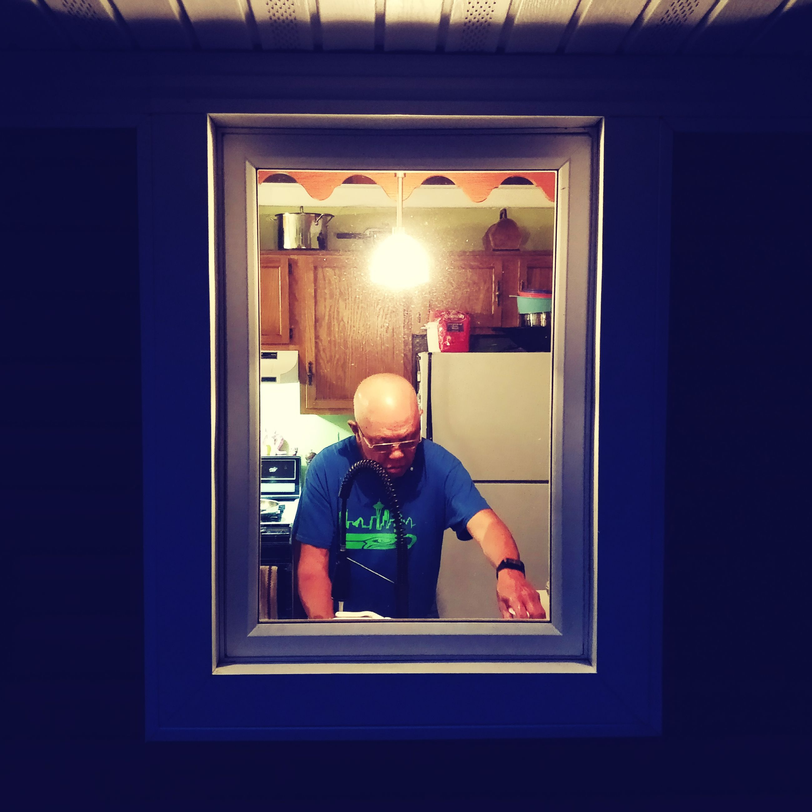 Man in kitchen after dark