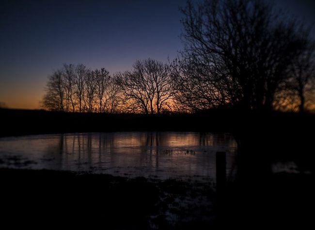 sunset over ice Reflection Ice Lowwintersun Samsø Silhouette Lake Sky Sunset No People