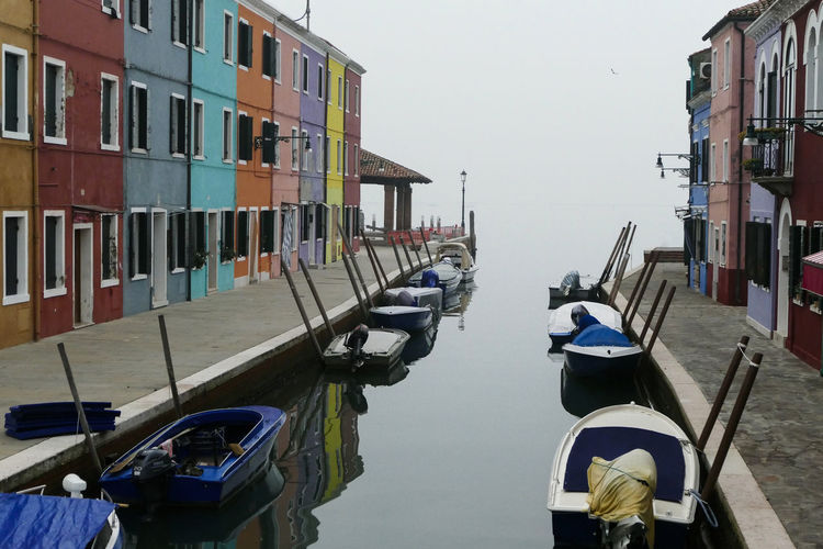 Boats moored in canal