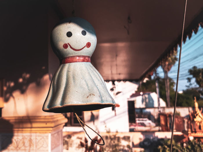 Close-up of ghost toy hanging outside house