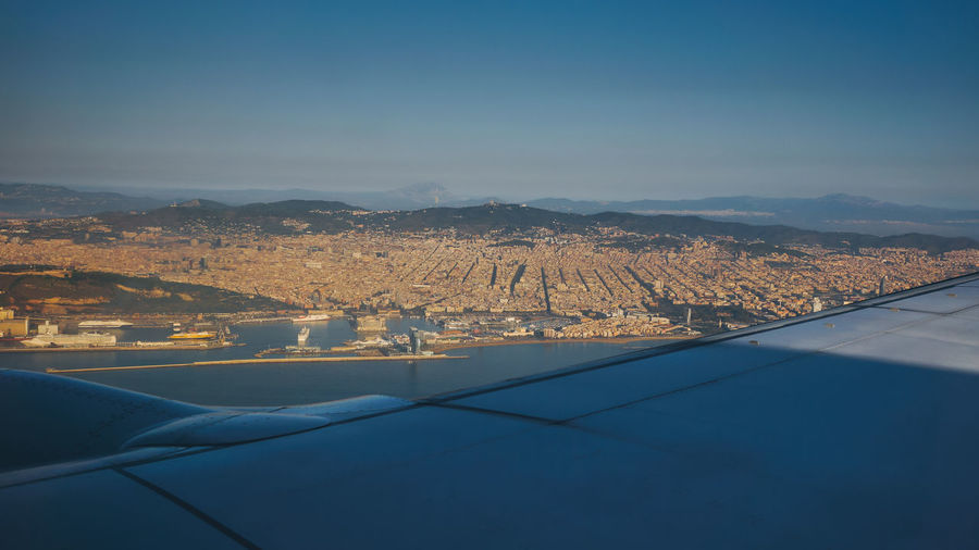 Aerial view on Barcelona Aerial View Aircraft Airplane Barcelona Bird's Eye View Cityscape Famous Place Flying Human Settlement Landscape Mountain Mountain Range Plane View Residential District Sky Tourism TOWNSCAPE Travel Destinations Traveling