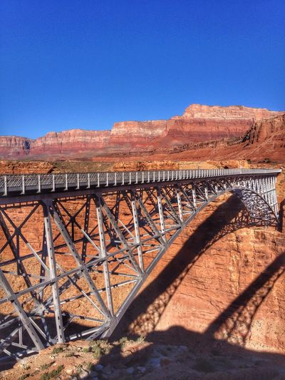 Navajo bridge over marble canyon against clear blue sky