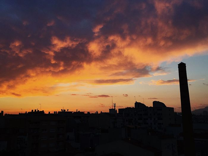 Sunset in Sabadell... Happy weekend!! Sunset Architecture Built Structure Building Exterior Silhouette Orange Color Sky Cloud - Sky No People City Cityscape Outdoors Travel Destinations Skyscraper Nature Beauty In Nature EyeEmNewHere Long Goodbye Skyporn Sunset Silhouettes Sunset_collection The Great Outdoors - 2017 EyeEm Awards