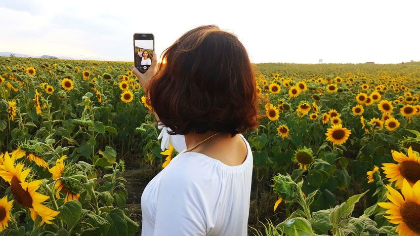 selfi.. An Eye For Travel Crop  Field Communication Growth Portable Information Device Smart Phone Flower People Nature Photography Themes Mobile Phone