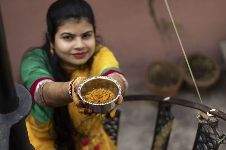 Portrait of a smiling woman holding food