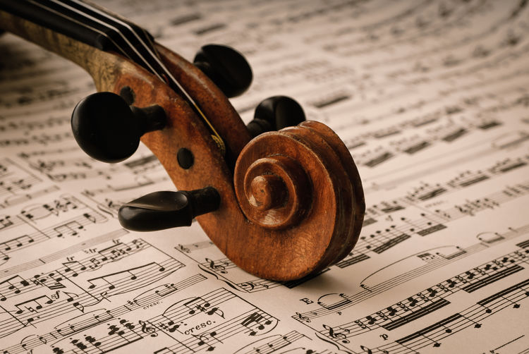 Part of a Violine Arts Culture And Entertainment Classical Music Classical Style Close-up Indoors  Music Musical Instrument Musical Instrument String Musical Note No People Paper Sheet Music String Instrument Violin