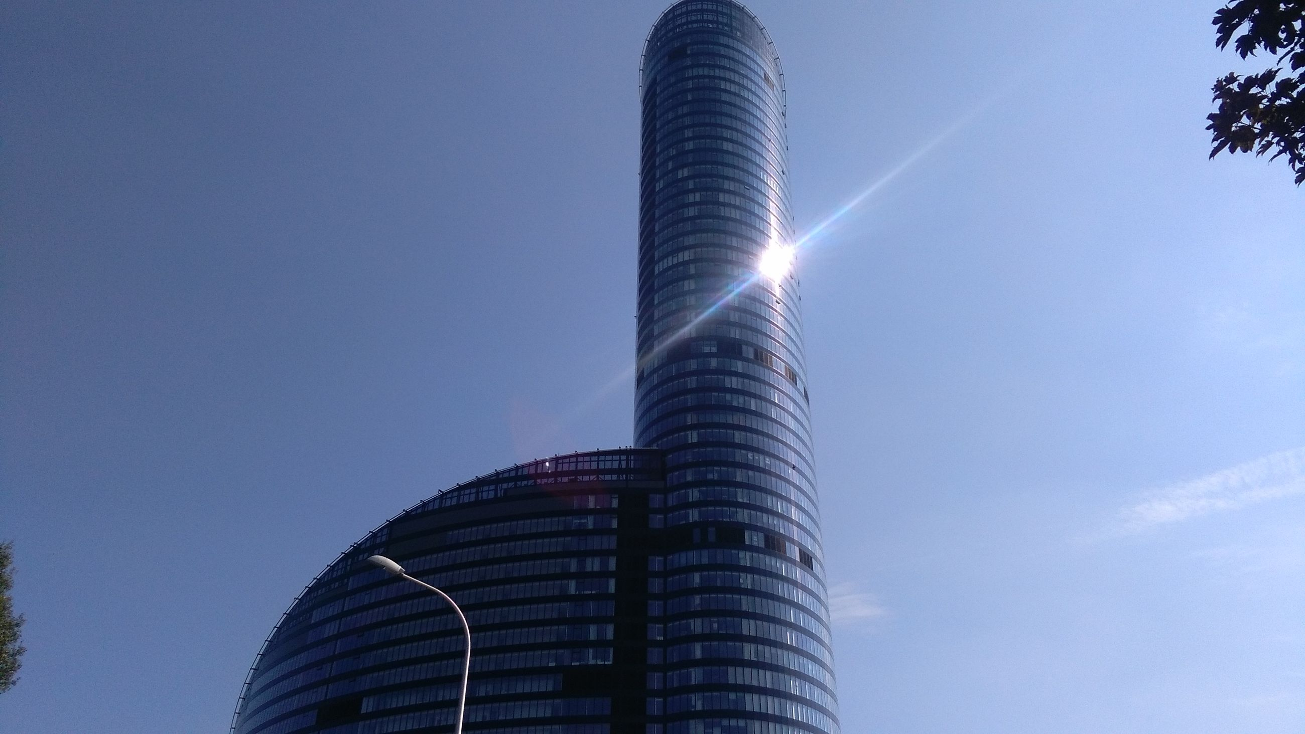 low angle view, architecture, skyscraper, built structure, modern, building exterior, no people, sky, day, outdoors, sunlight, city, travel destinations, clear sky