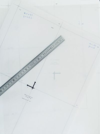 Close-up of blueprint and ruler