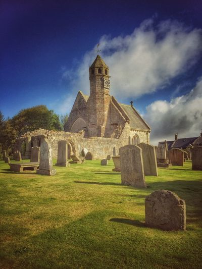 St Brides church Architecture Grass Built Structure History Building Exterior Cemetery Tombstone Religion Famous Place Sky Outdoors The Past Travel Destinations Death Old Ruin Ancient Blue Stone Material Tranquil Scene Church
