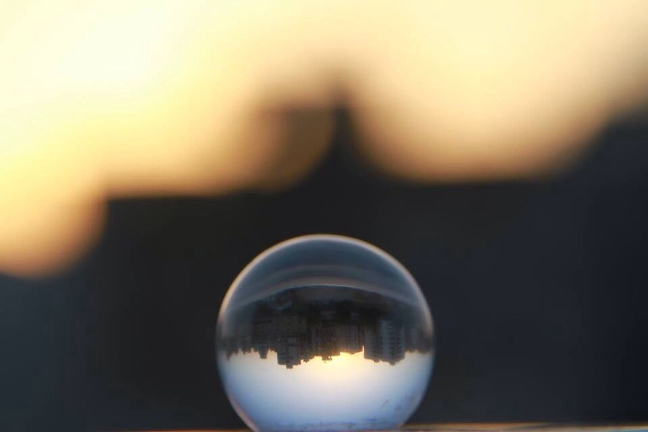 reflection, sunset, focus on foreground, sky, close-up, silhouette, circle, copy space, water, dusk, sphere, glass - material, transparent, nature, illuminated, outdoors, no people, selective focus, clear sky