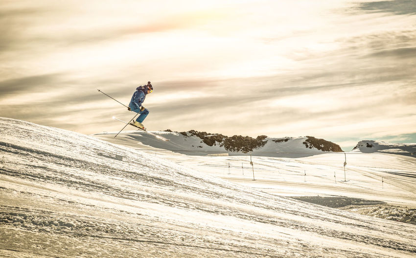 Man Skiing On Snow Against Sky