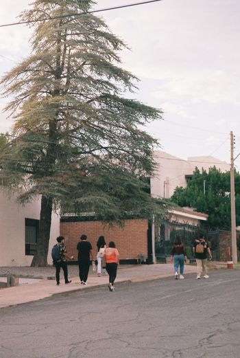 People walking in front of building