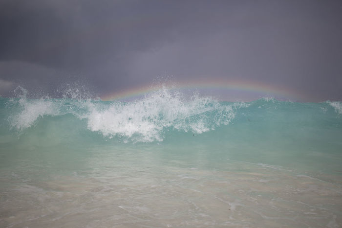 A wave and a rainbow in Saint John - Trunk Bay Beautiful Beauty In Nature Blue Caribbean Clear Clear Water Day Motion Nature No People Outdoors Picturesque Power In Nature Rainbow Saint John Sea Sky Splash Splashing Stormy Trunk Bay Water Wave Waves