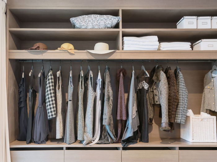modern closet with row of dress hanging on coat hanger in wardrobe. Abundance Arrangement Choice Closet Clothing Coathanger Collection Fish For Sale Hanging In A Row Indoors  Large Group Of Objects Menswear No People Order Rack Retail  Retail Display Shelf Still Life Variation