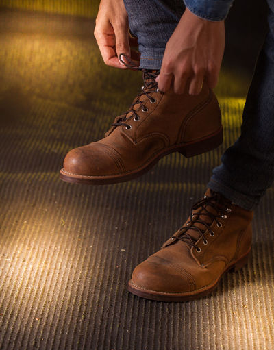 Low section of man wearing leather shoes