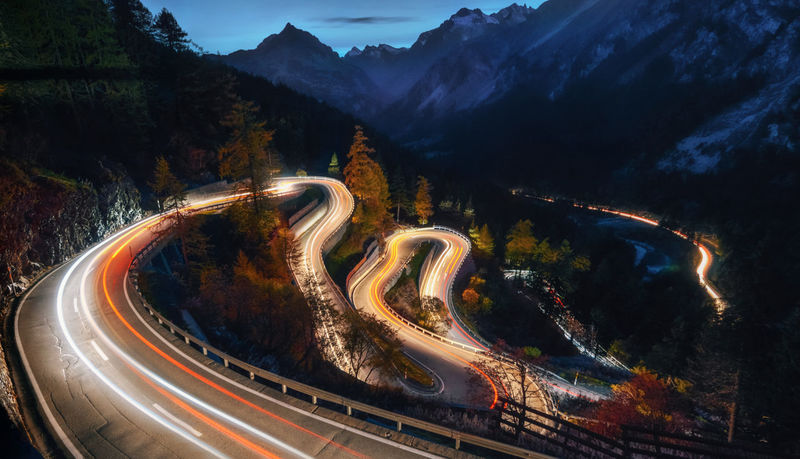 The winding mountain road at the night with light tracks from cars, Maloja Pass, Switzerland Pass Beauty In Nature Curve High Angle View Illuminated Light Trail Long Exposure Motion Mountain Nature Outdoors Road Switzerland Switzerlandpictures Transportation Winding Road Mobility In Mega Cities Go Higher