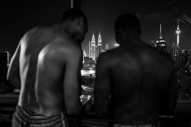 Kuala Lumpur Men Rear View Architecture Built Structure Adult Religion Shirtless Spirituality Standing Waist Up Night Place Of Worship Indoors  Real People Belief Human Back Petronas Twin Towers