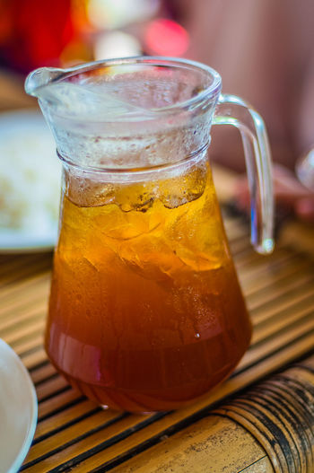 Close-Up Of Lemon Tea In Jug On Table