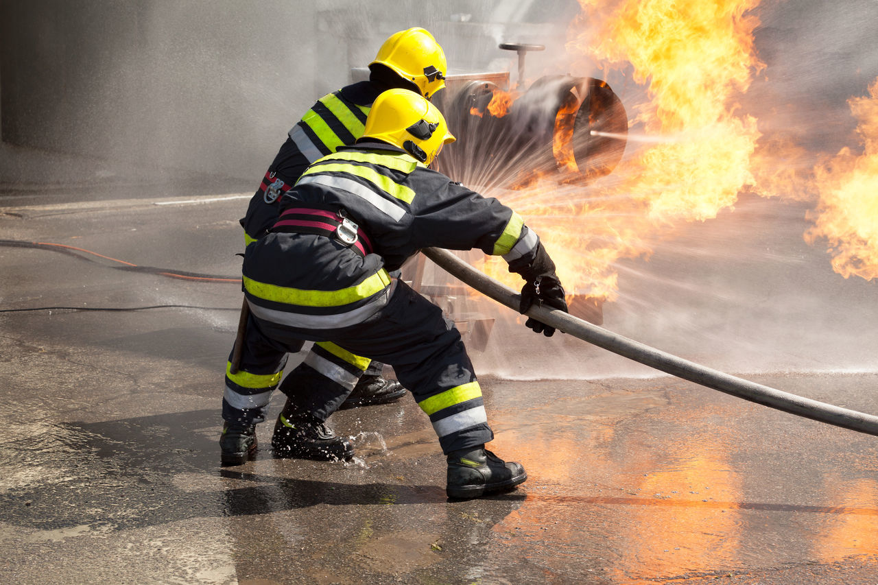 fire hose, firefighter, danger, spraying, protective workwear, headwear, heat - temperature, risk, protection, courage, safety, heroes, helmet, men, work helmet, emergency equipment, sports training, full length, holding, flame, uniform, water, responsibility, only men, occupation, one man only, one person, standing, day, adult, working, indoors, occupational safety and health, people, adults only
