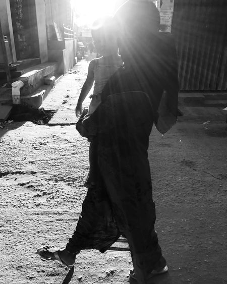 Only Men Sunlight Built Structure Outdoors One Man Only Adults Only Adult People One Person Architecture Building Exterior Day City Men Jashimsalam Photographer The Street Photographer - 2017 EyeEm Awards The Great Outdoors - 2017 EyeEm Awards Real People Road One Woman Only Walking City Street Sunlight Black And White