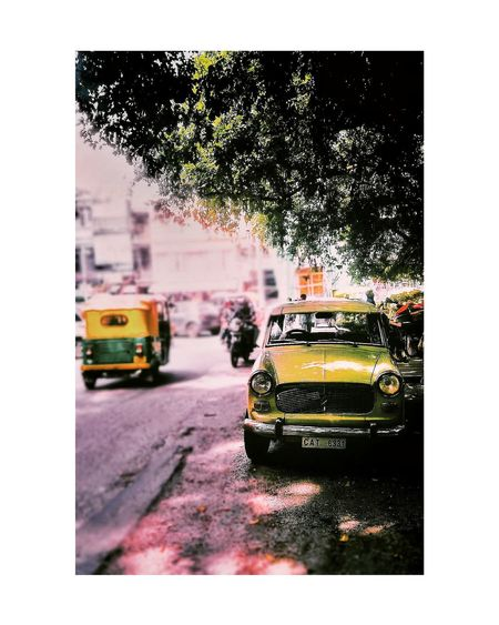 Car Transportation Land Vehicle Mode Of Transport Yellow Taxi Street Taxi Traffic City Street Wet Road Outdoors City Day Motion No People Sky Streetphotography Moodygrams Streetsofindia👣 Cityscapes Indianphotography Indiaclicks India_gram Bangaloredairies