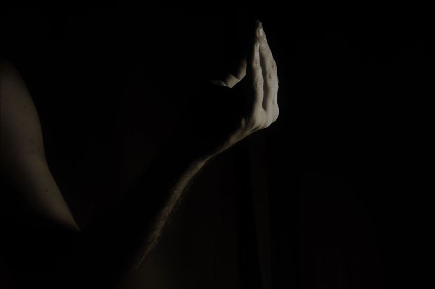 Greeting Low Light Black Background Close-up Dark Hand Gestures Light And Shadow One Person People