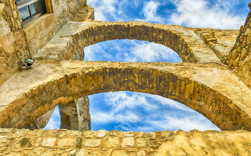 Ruins of an old castle in Fiumefreddo Bruzio, small village in south of Italy Architecture Arch Built Structure Sky Cloud - Sky The Past History No People Day Building Exterior Nature Low Angle View Ancient Old Ruin Old Sunlight Travel Destinations Ancient Civilization Solid Building Outdoors Archaeology Ruined Architectural Column Stone Wall