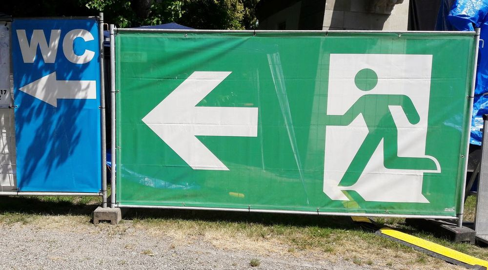 Hurry up.. Festival Signs Wc Emergency Exit Emergency Sign Festival Season Summer Outdoors Open Air Park Piktogram Day No People Festival Fear Safety Safety First Festivals