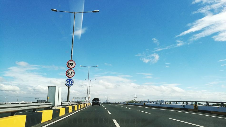 Transportation Road Cloud - Sky Car Road Sign City Travel Destinations Sky Street Travel Day Outdoors Bridge - Man Made Structure No People Architecture Urban Skyline Cityscape Politics And Government