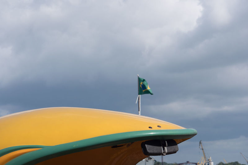 Twice yellow and green Brasilian Flag Cloud Coco Taxi Cuba Cuba Collection Day Flag No People Outdoors Travel Photography