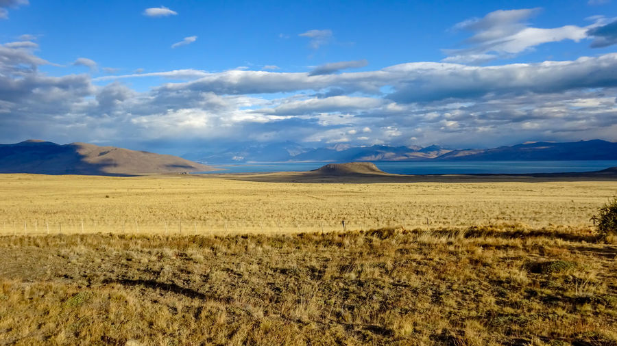 Cloud - Sky Landscape Sky Environment Tranquil Scene Tranquility Beauty In Nature Scenics - Nature Land Non-urban Scene Nature No People Day Mountain Remote Field Desert Sunlight Idyllic Grass Arid Climate Climate Semi-arid