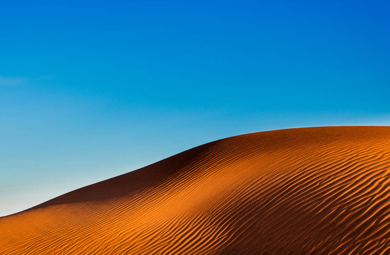 17.62° Desert Dunes Sky Blue Sand Dune No People Pattern Non-urban Scene Scenics - Nature