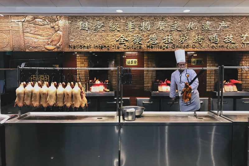 Beijing duck Food And Drink Restaurant Tradition Food Retail  Food And Drink Industry Men Commercial Kitchen Indoors  Real People Bakery Freshness Store Display Cabinet Meat Food And Drink Establishment Service Occupation Working Day Duck Beijing Duck Food Stories