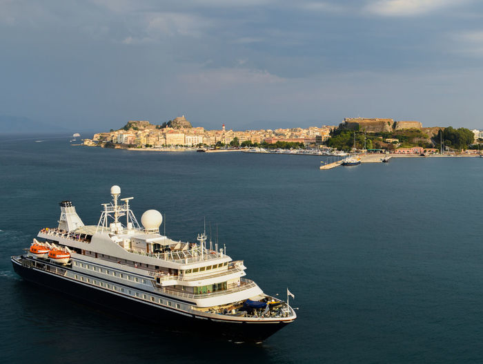 CORFU ISLAND Ferry Ferryboat Holiday Architecture Building Exterior Built Structure Clouds And Sky Corfu Corfu City Day Go-west-photography.com Greece High Angle View Ionian Islands Ionian Sea Nature Nautical Vessel No People Outdoors Sea Sky Summer Travel Destinations Water