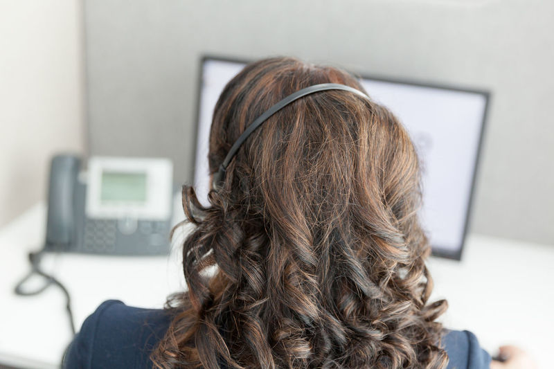 Rear view of woman working in office