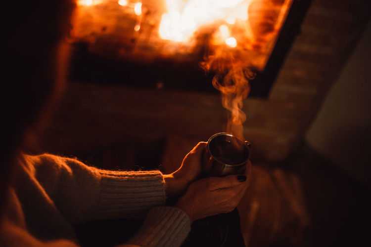 Midsection of man holding bonfire
