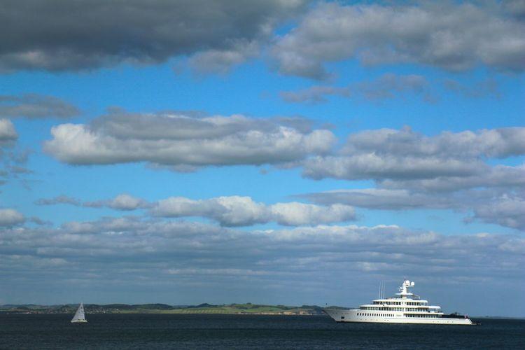 Ship sailing in sea against sky
