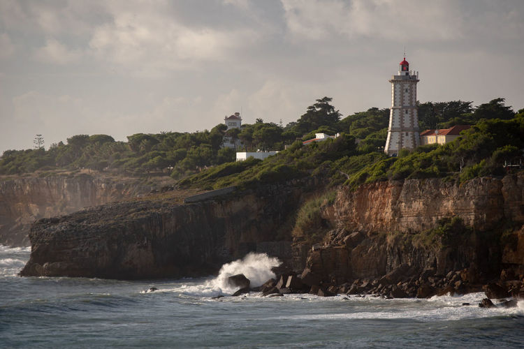 view of lighthouse by sea against sky Architecture Building Building Exterior Built Structure Cloud - Sky Day Guidance Land Lighthouse Motion Nature No People Outdoors Scenics - Nature Sea Sky Tower Travel Travel Destinations Water Waterfront