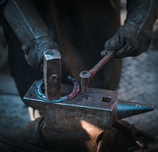 Close-up of man working on metal