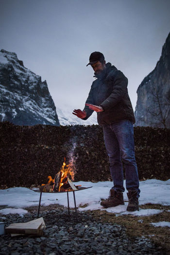 Camping Hiking Snow ❄ Bonfire Burning Campfire Cold Temperature Fire Fire - Natural Phenomenon Flame Full Length Leisure Activity Lifestyles Men Nature One Person Outdoors Real People Side View Snow Standing Warm Clothing Winter