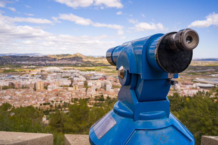 A Panoramic binocular on the top of the Xativa castle (Fortress), Spain Architecture Sky Building Exterior City Built Structure Cityscape Binoculars Cloud - Sky Coin Operated Nature Building Day No People Residential District Blue Outdoors Coin-operated Binoculars Observation Point Landscape Hand-held Telescope Binoculars Landscape Panoramic Xativa Spaın Valencia, Spain