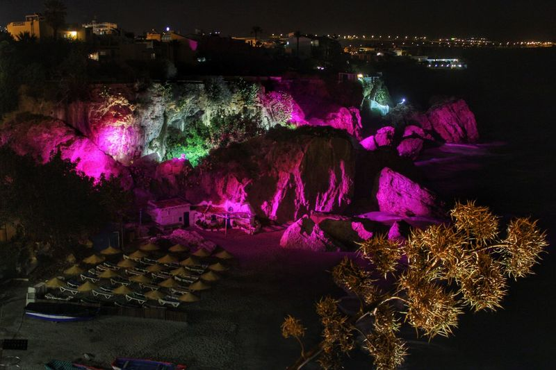 Nighttime rock illuminations, Nerja Spain Coastal Illuminations High Angle View Illuminated Landscapes With WhiteWall Nerja Nerja Andalucia Nerja Coast Nerja Coast At Night Nerja Illuminated Rocks Night Nighttime Illuminations Nighttime Lights Pink Color Purple Purple Illuminations Purple Lights Rocks Illuminated Purple