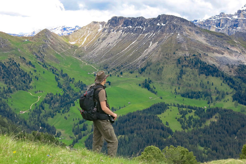 Side view of male hiker standing against mountain at south tyrol