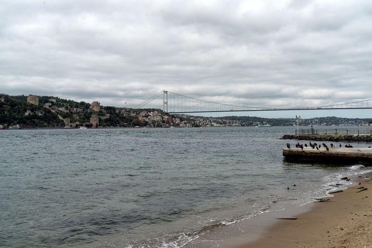Scenic view of bay bridge against sky